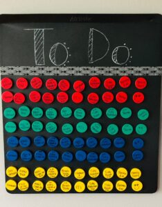 """DIY Magnetic Chore Chart, labeled """"To Do"""" with four different colored magnets."""