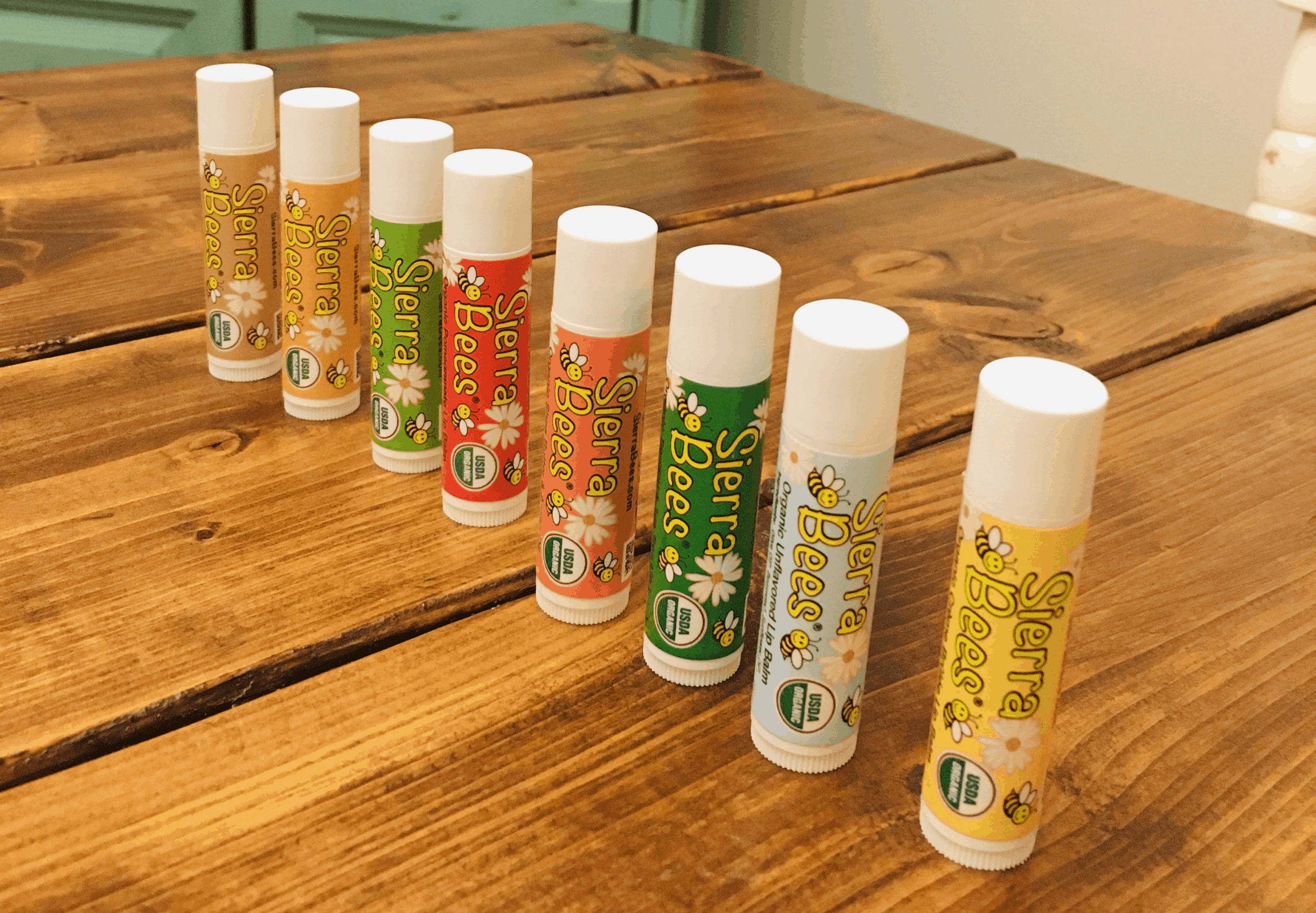 a row of sierra bees lip balm flavors
