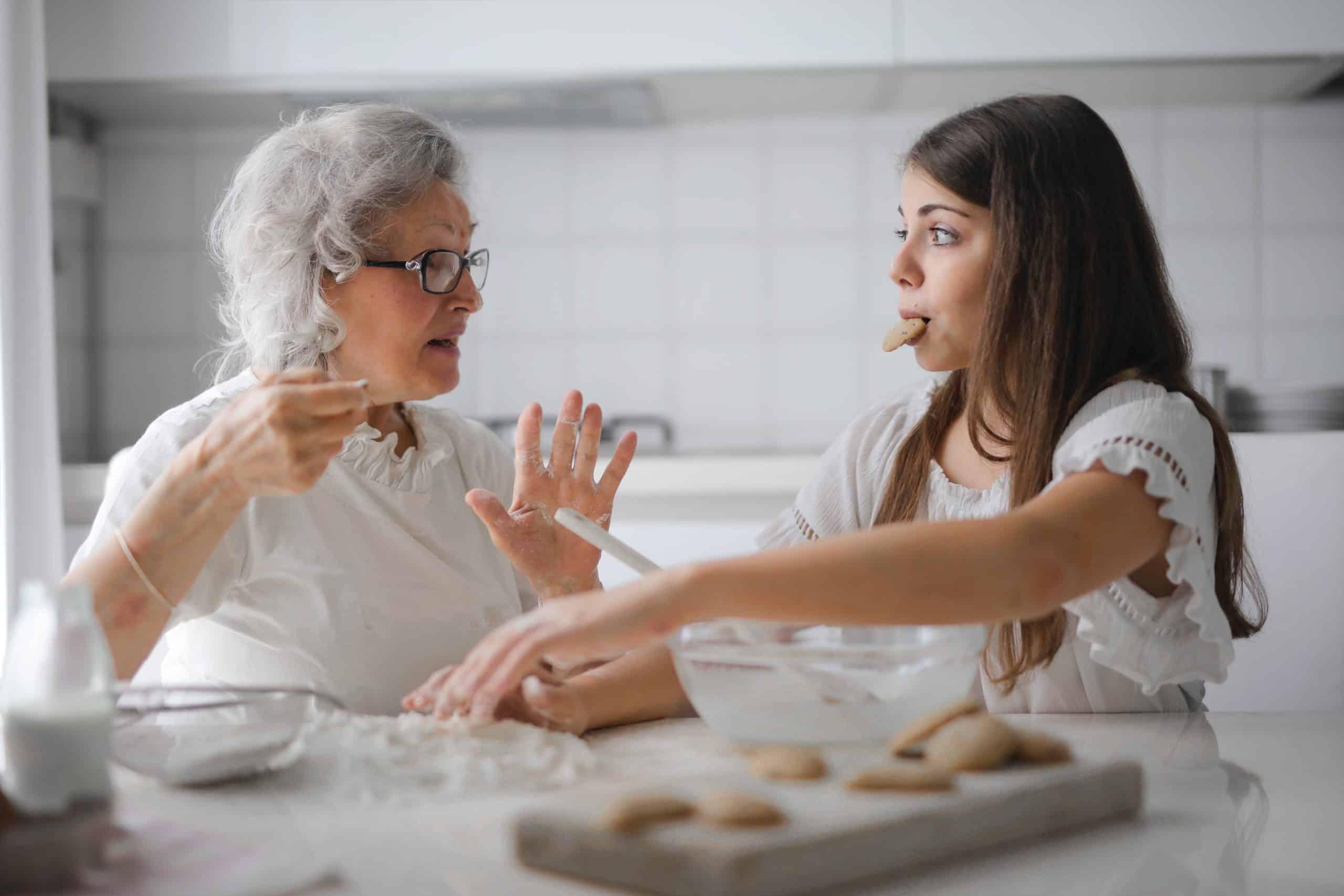Grandma teaching homemaking skills to daughter