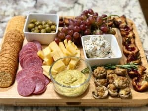 Charcuterie board with great snacks for a date night in