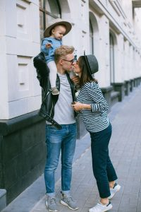 woman boosting her husband's confidence with a kiss