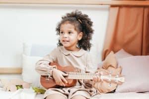 Tech-Free Thursday: girl playing ukulele