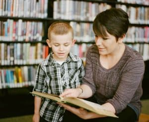 To...Tuesday: mom reading book to son at the library