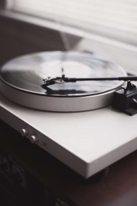 Record player: playing music for date night in