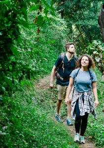 Couple hiking on a trail for a date night for couples