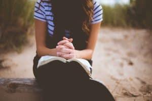 woman praying for husband