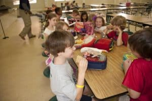 students eating lunch in a cafeteria