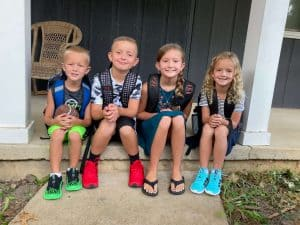 Four kids heading to first day of school