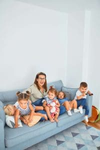 Mom with kids on the couch