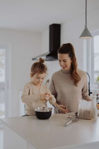 Mom and daughter baking in the kitchen together