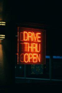 """Drive Thru Open"" neon sign"